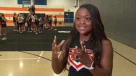 High School Cheerleader Jumps Off Float and Saves Choking Toddler