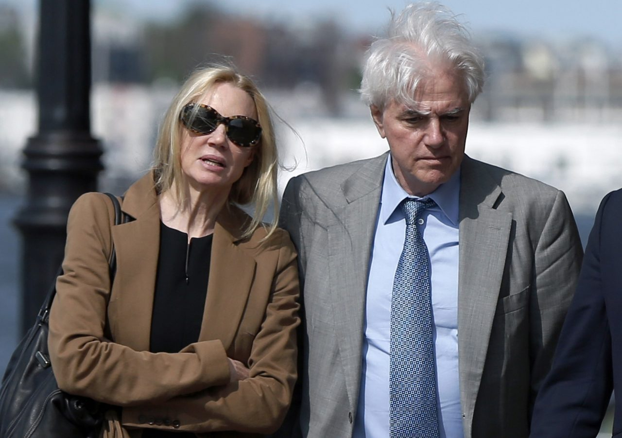 In this May 22, 2019 file photo, Marcia, left, and Gregory Abbott leave federal court after they pleaded guilty to charges in a nationwide college admissions bribery scandal. (Michael Dwyer/AP Photo, File)