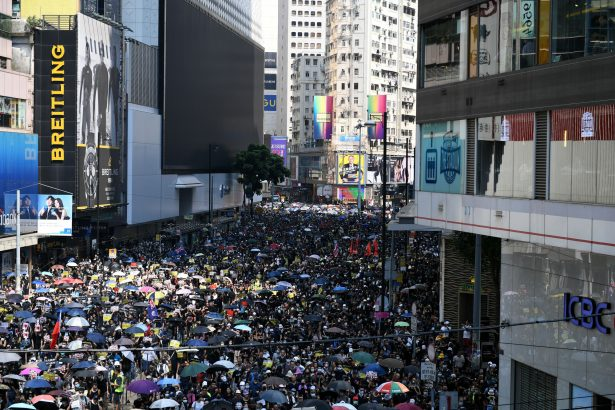 'We Are Mourning:' Thousands of Hongkongers March on Communist Party Anniversary Despite Ban