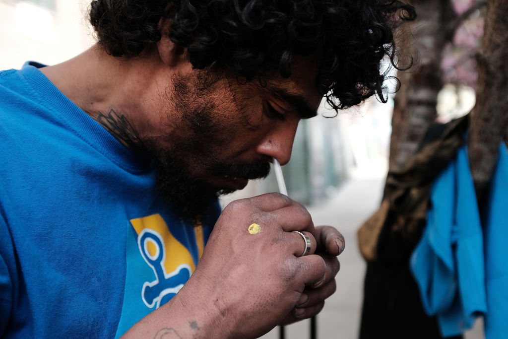 Eliezer, a 38 year old homeless heroin addict, snorts heroin in the Bronx on May 4, 2018 in New York City. Eliezer often snorts his heroin instead of injecting as he feels it lessens the chances of overdosing on the drug. (Spencer Platt/Getty Images)
