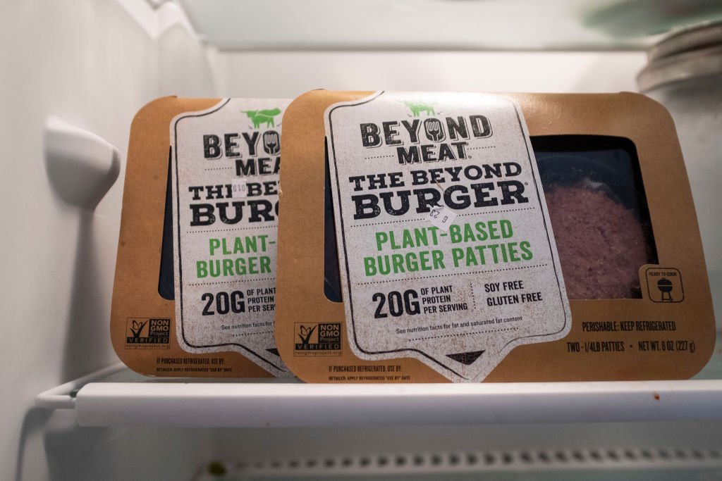 """Packages of Beyond Meat """"The Beyond Burger"""" sit in a refrigerator, June 13, 2019 in the Brooklyn borough of New York City. Beyond Meat is a Los Angeles-based producer of plant-based meat substitutes, including vegan versions of burgers and sausages. (Photo Illustration by Drew Angerer/Getty Images)"""
