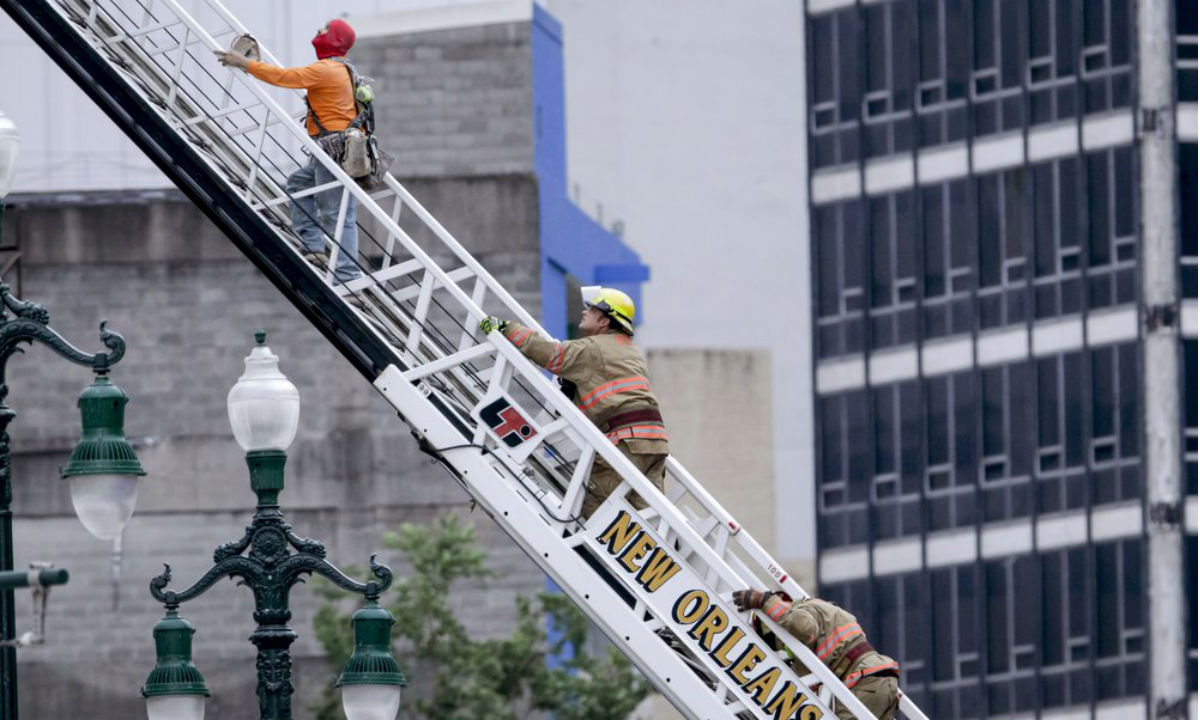 Rescued worker and a firefighter