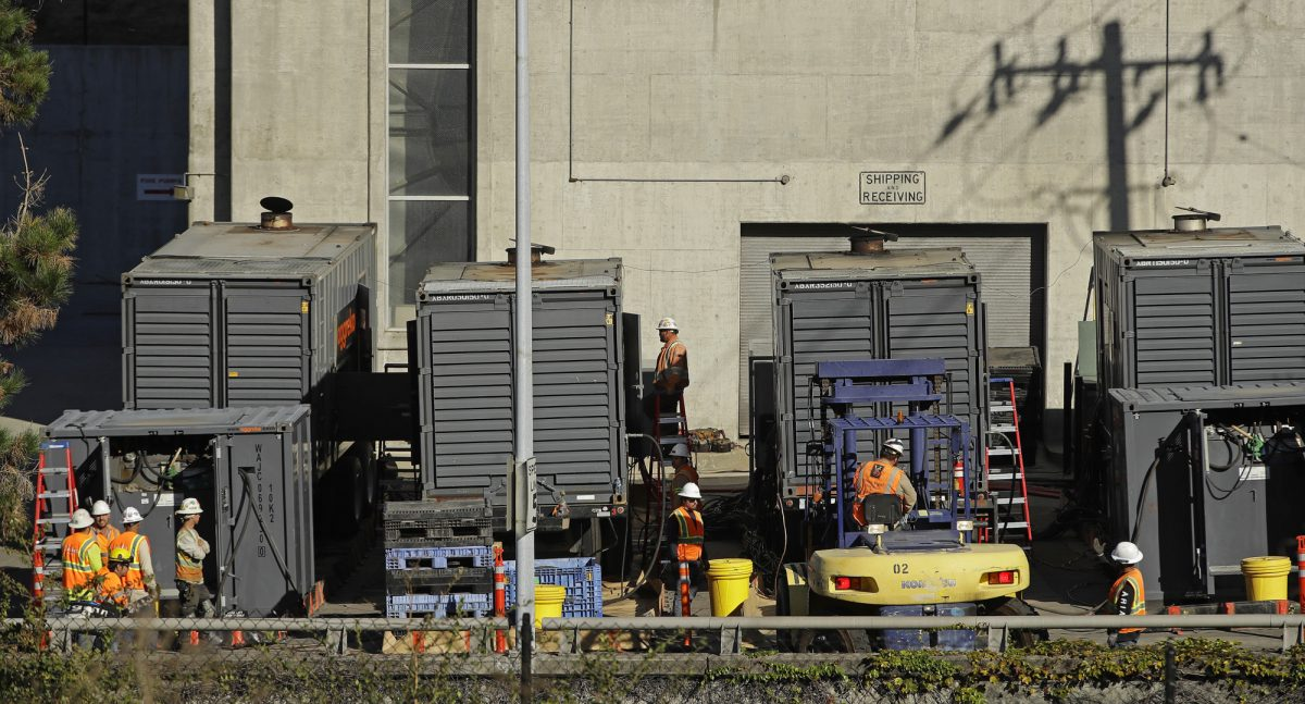 Crews work to connect generators