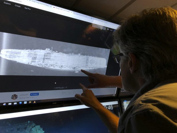 Rob Kraft looks at images of the Japanese aircraft carrier Kaga