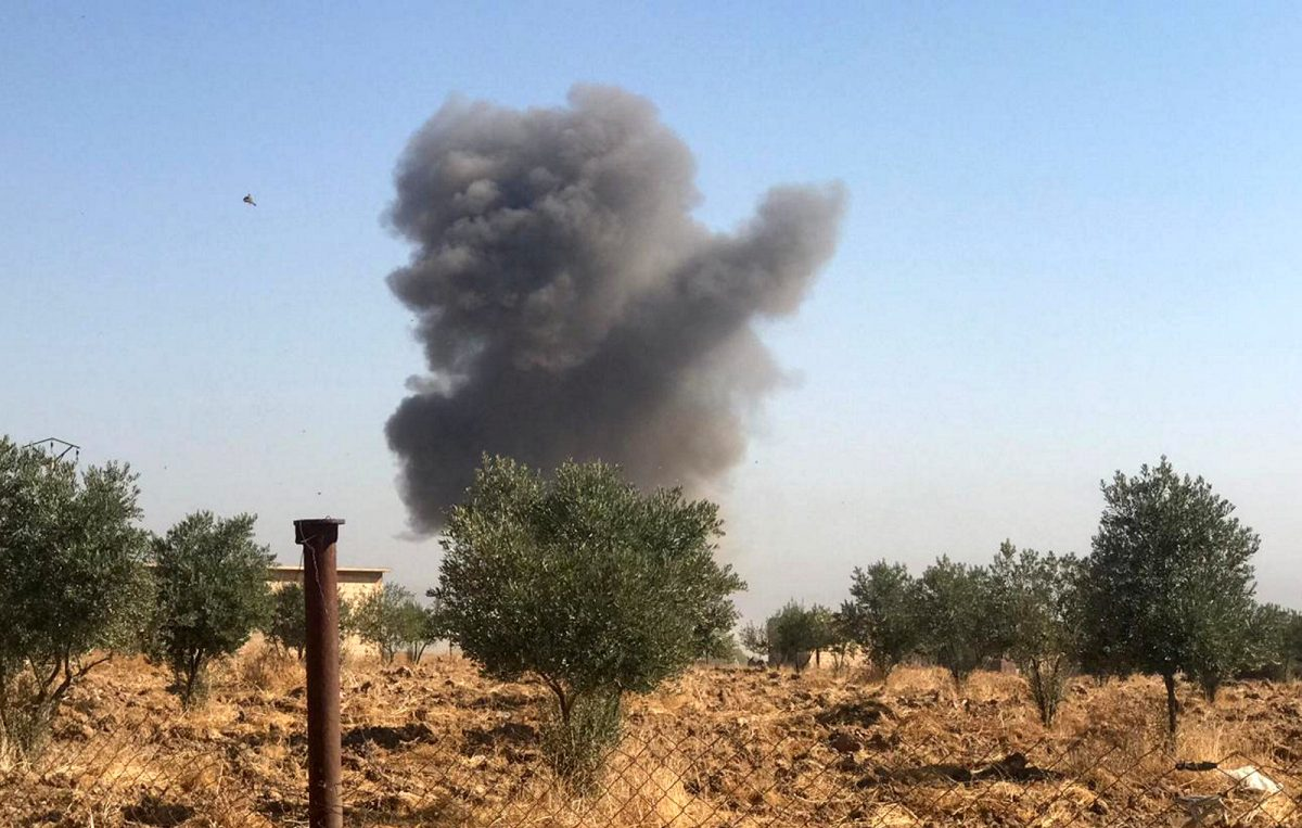 Smoke rises from Tel Arkam village
