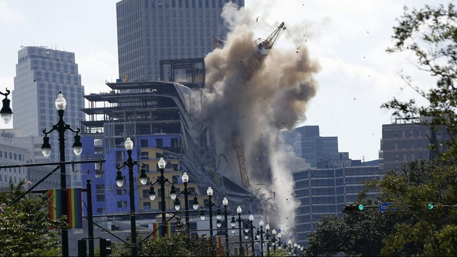2 Leaning Cranes Toppled at Partly Collapsed New Orleans Hotel