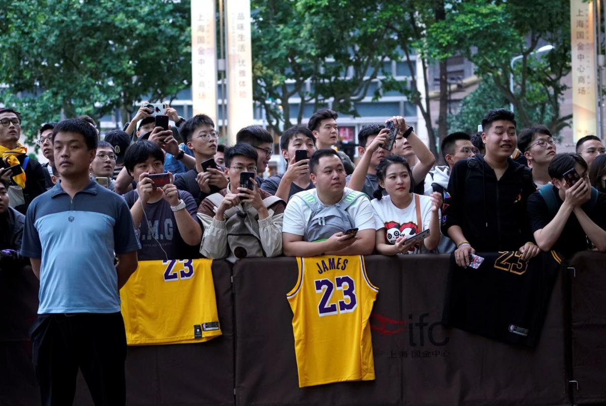 NBA fans wait outside a Ritz-Carlton hotel