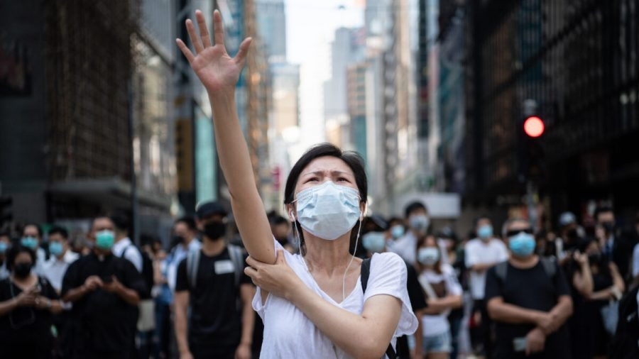 2 Protesters Have Been Charged Under Hong Kong's Emergency Anti-Mask Law