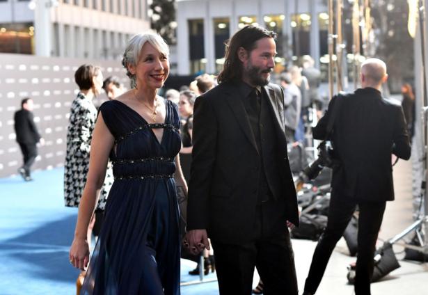 Alexandra Grant and Keanu Reeves arrive