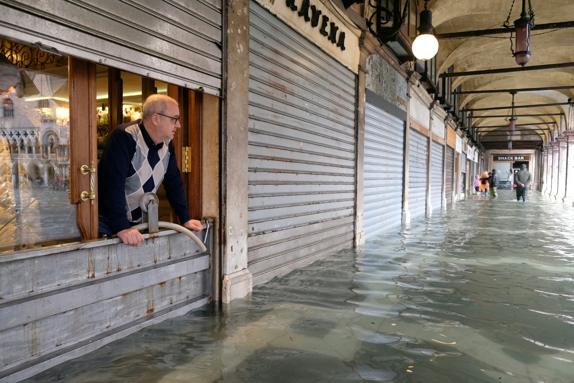 Man, Venice flooding