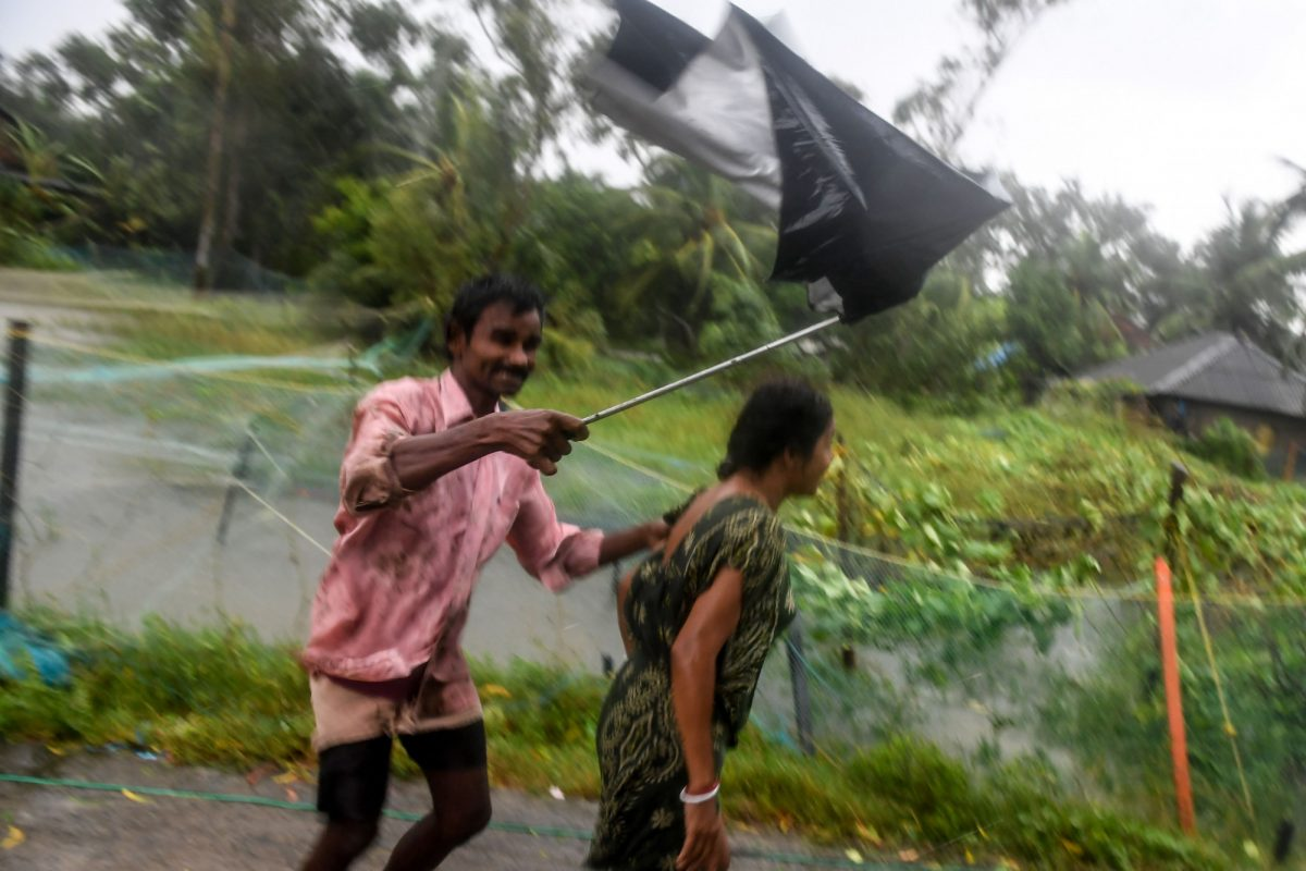 Villagers struggle against strong winds
