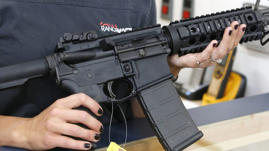 Florida Man Says His Pregnant Wife Saved His Life in Home Invasion With an AR-15