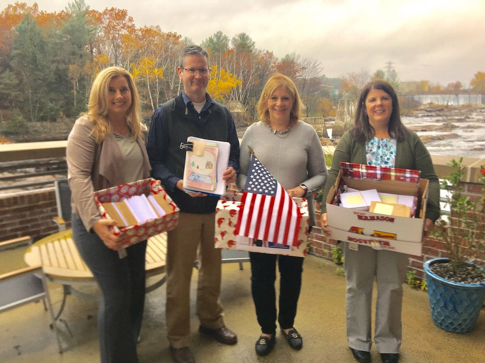 Laura Landerman-Garber, second from right, founded a nonprofit that sends thousands of cards to US military