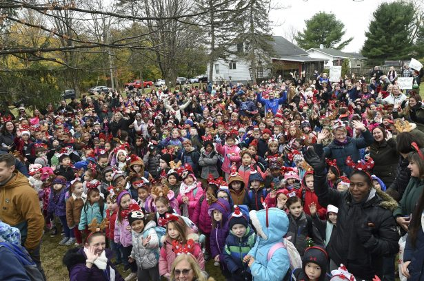 Students from local elementary schools cheer