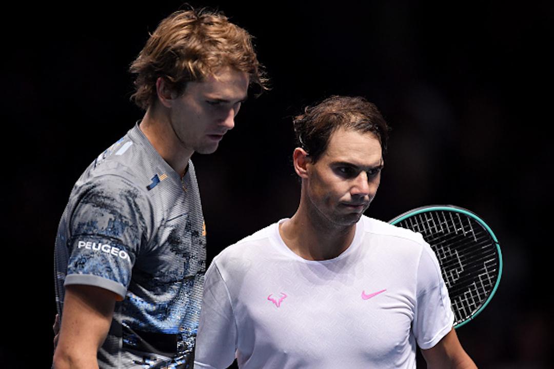 Rafael Nadal of Spain and Alexander Zverev of Germany embrace