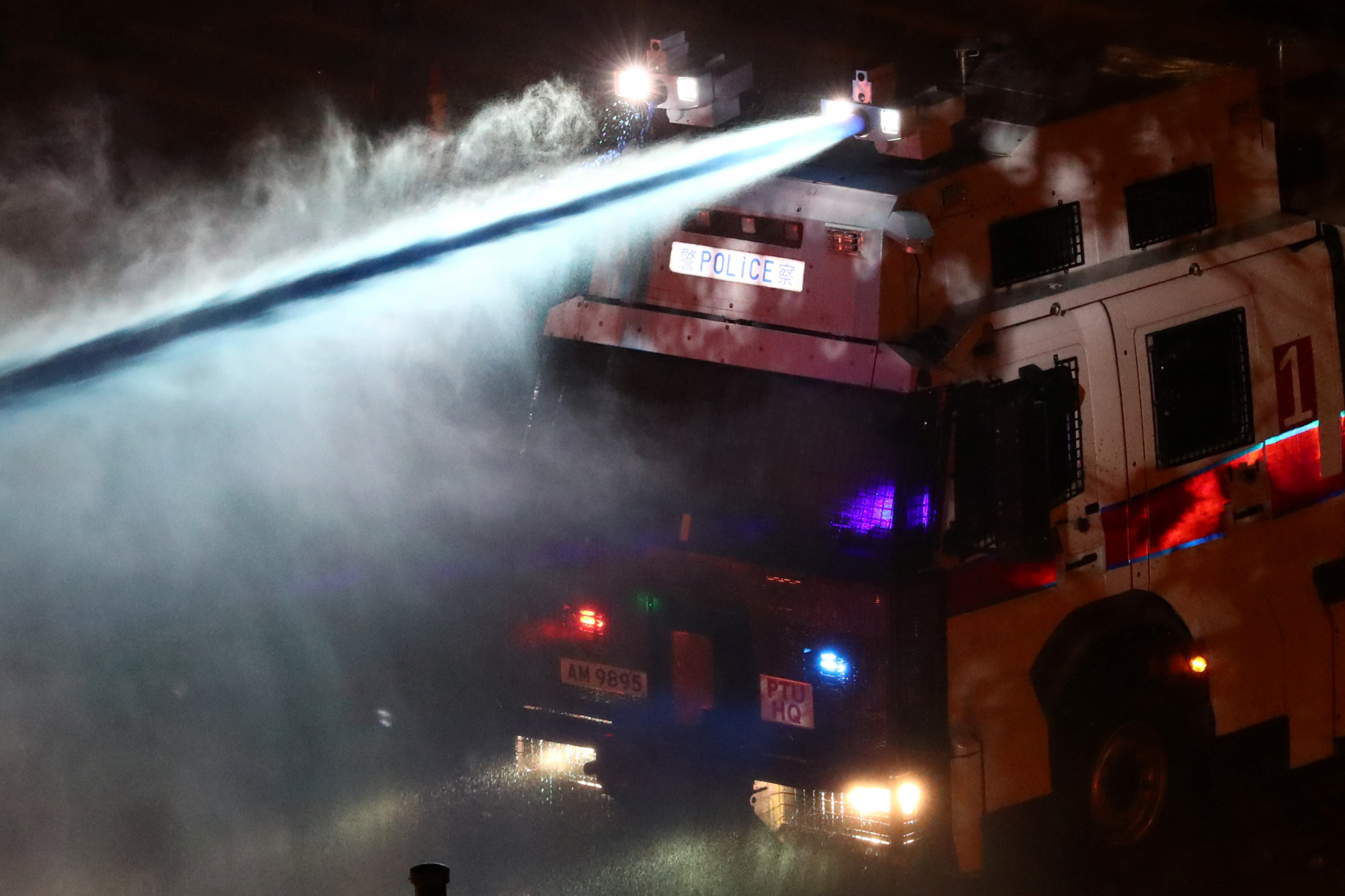 Police fires a water cannon