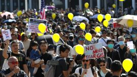 Parents, Children Standing Side-by-Side Demand HK Police Stop Using Tear Gas