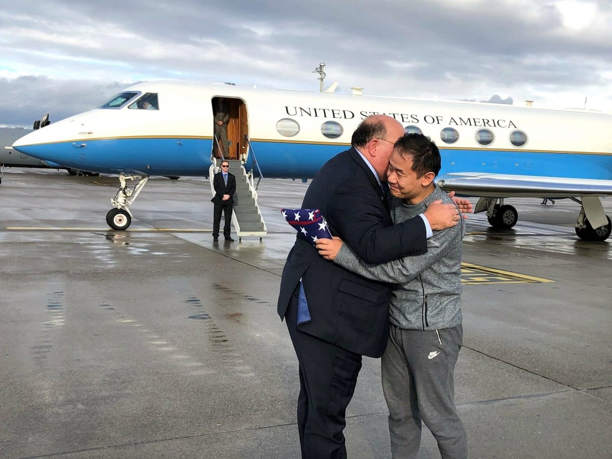 Edward McMullen hugs Xiyue Wang