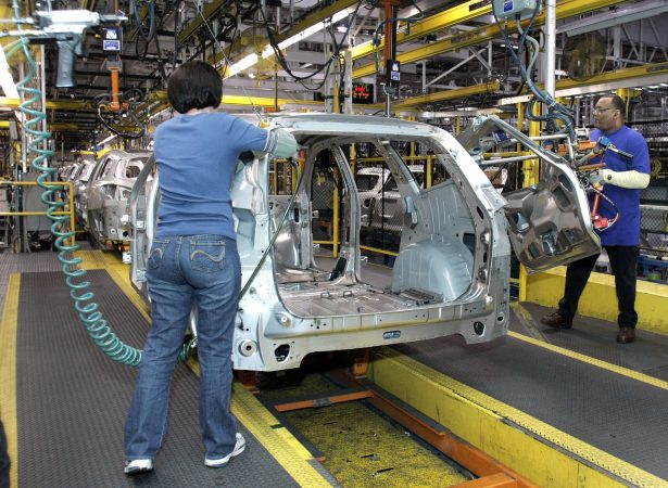 Workers build a GM crossover SUV