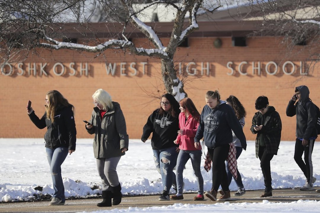 Students are evacuated from the scene of an officer invloved shooting