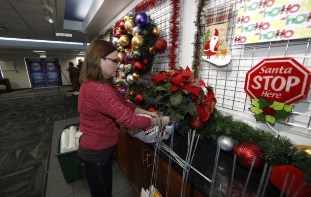 Volunteer Nicole Schreiner places a display