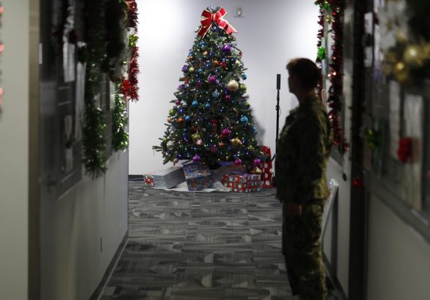 A decorated tree stands in the NORAD Tracks Santa Center