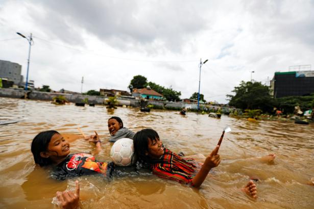Girls play in flood
