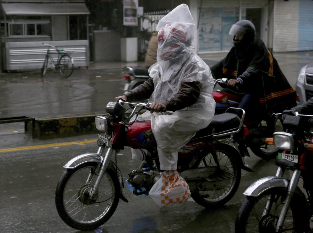 A motorcyclist covers himself with plastic