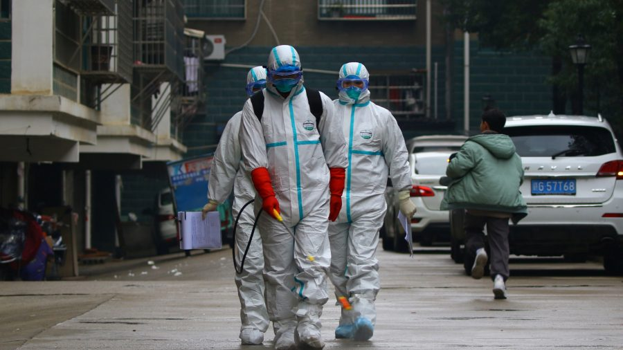 Death Toll in China from Viral Outbreak Rises to 56 As Confirmed Cases Top 2,000