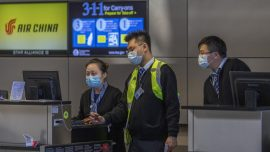 US Travel Restrictions Go Into Place to Curb Coronavirus Spread