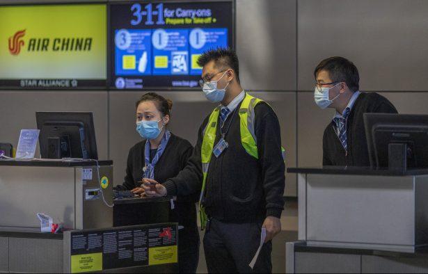 Air China employees wear medical masks