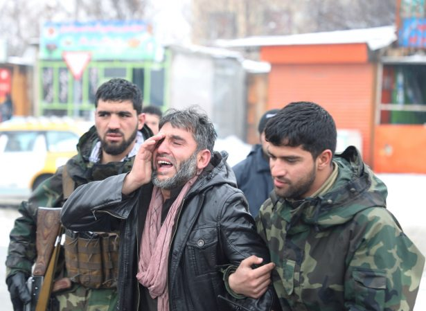 An Afghan man reacts suicide attack in Kabul Afghanistan