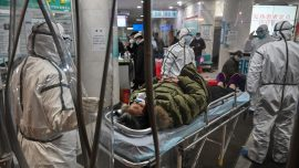 China Funeral Homes Overloaded Amid Virus