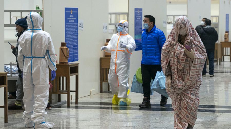 China expert: Virus epidemic to peak later this month