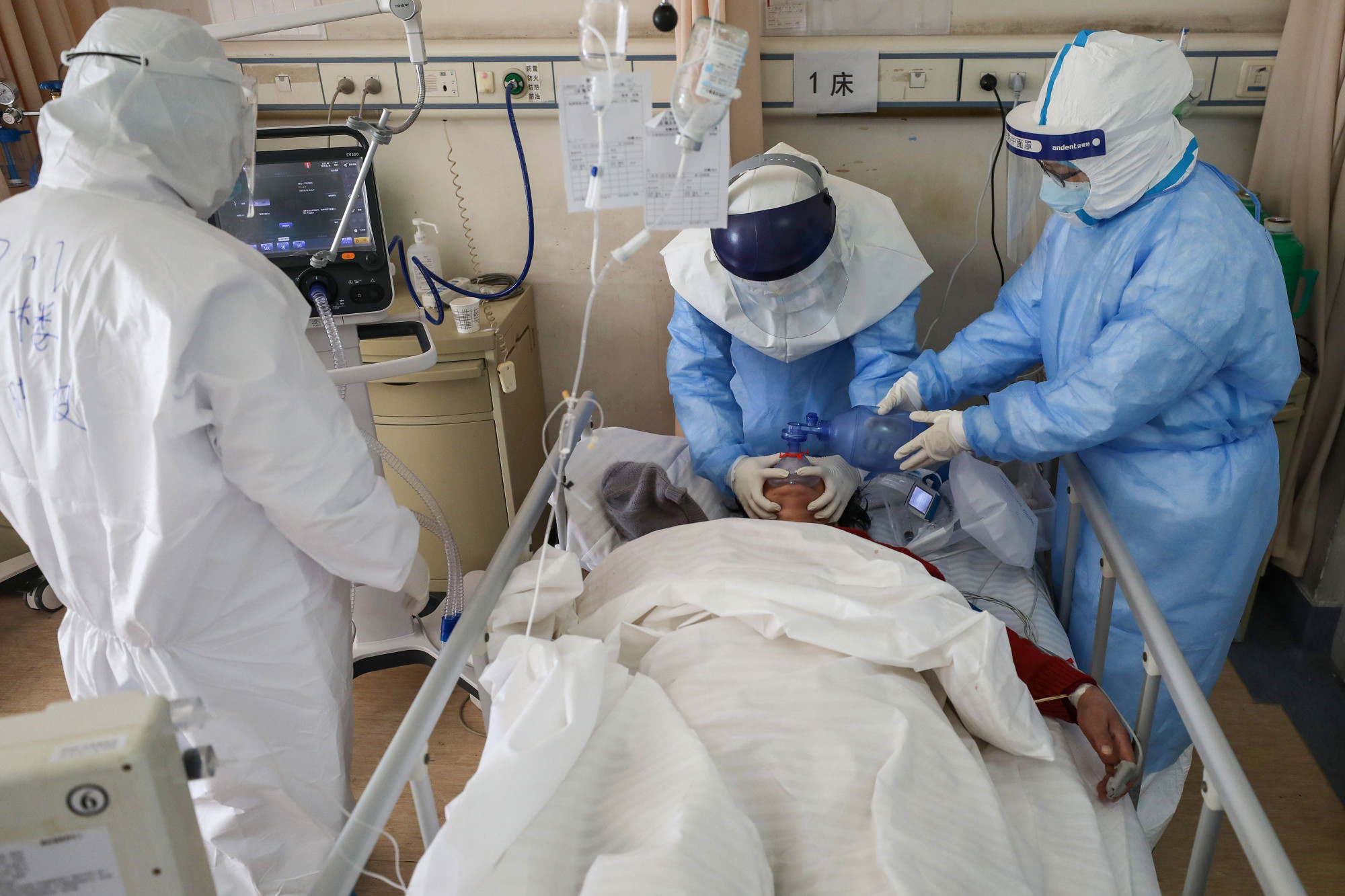 Medical staff members treating a patient