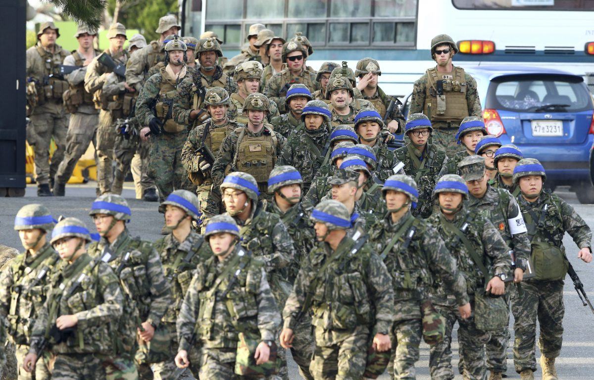 South Korean Marines, wearing blue headbands