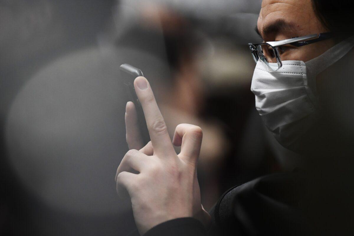 A commuter wearing a face mask