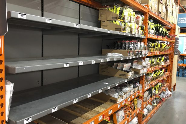 Shelves that previously held masks and respirators are bare at a Home Depot