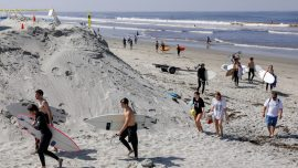 Beach Crowds Lead California to Step up Enforcement of CCP Virus Restrictions