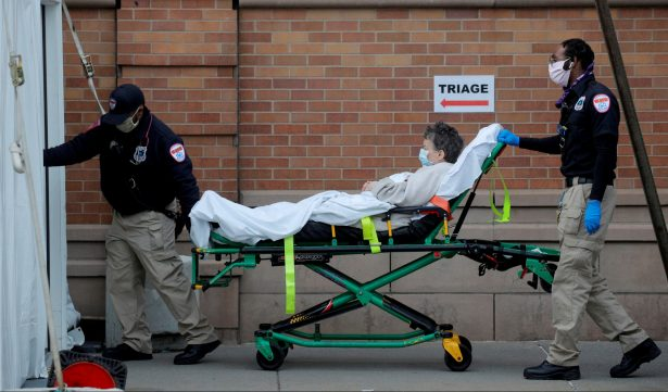 Paramedics take a patient into the emergency center