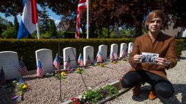 Volunteers Put Faces to Names of Americans in WWII Cemetery