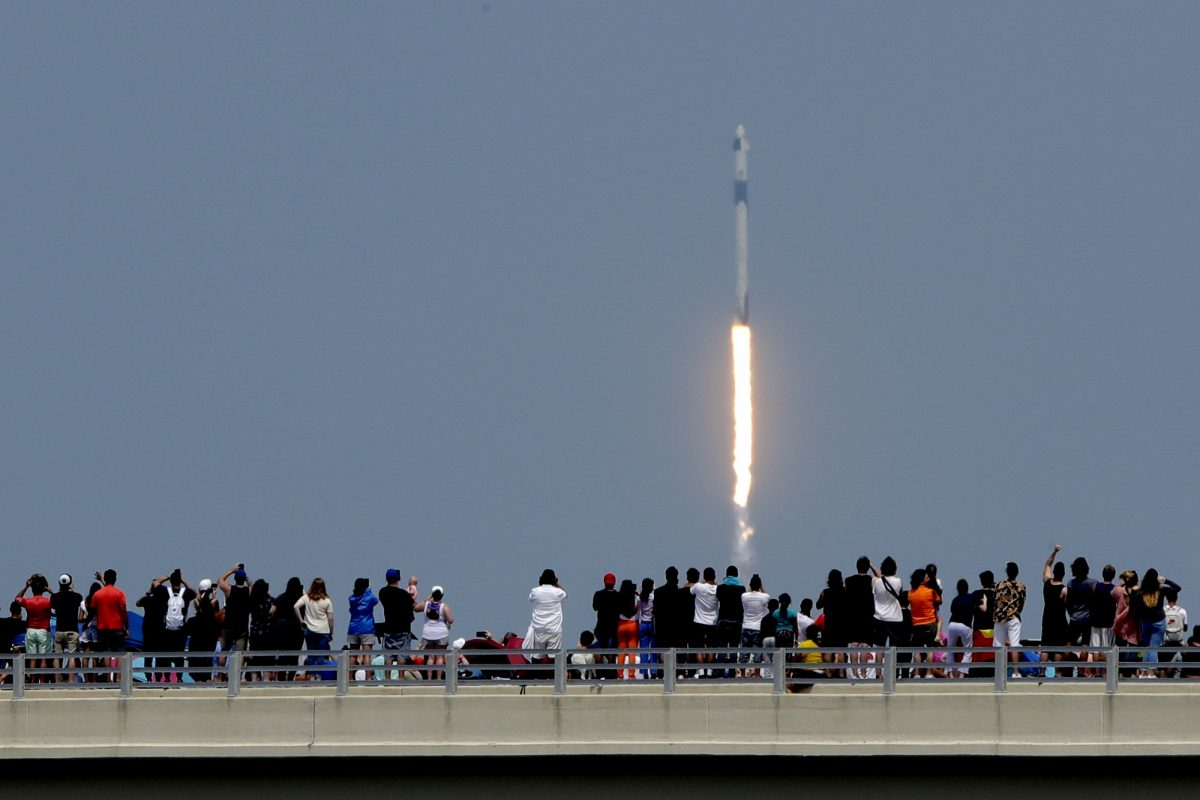 Spectators watch SpaceX launch