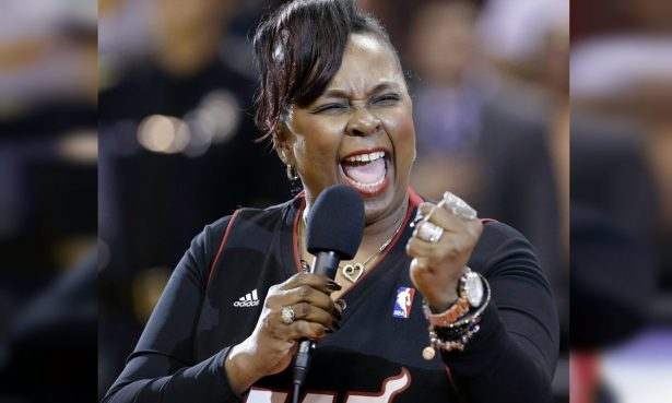 Singer Betty Wright performs the national anthem before an NBA basketball game