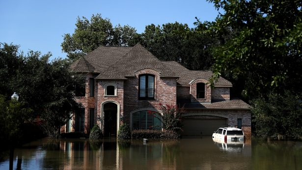 Floodwaters surround a home in Houston