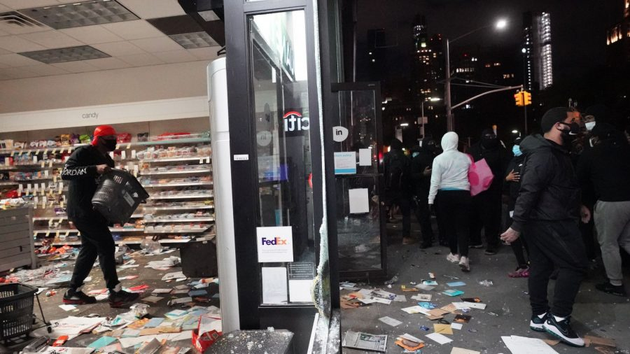 Woman Beaten by Looters While Trying to Protect Business in New York