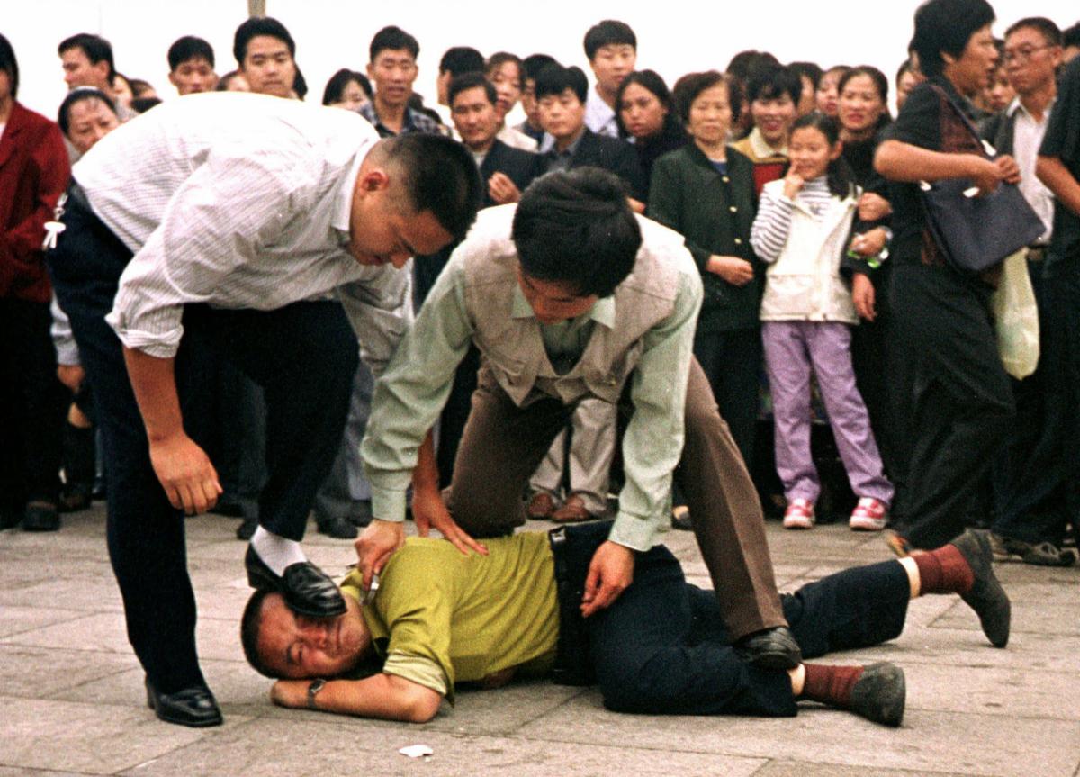 Police detain a Falun Gong protester
