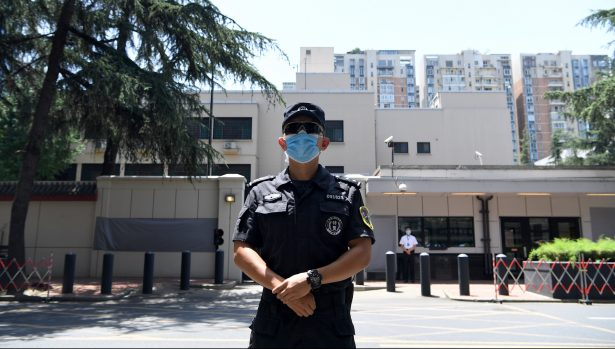 A police stand guard in front of the US Consulate