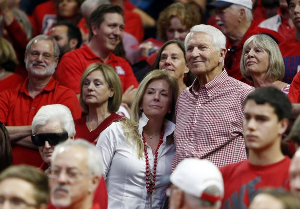 Kelly and Lute Olson stand during the second half of Arizona's NCAA college basketball game