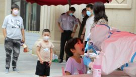 China's Xinjiang Region Pushes More Lockdown Measures In Response to Virus, Drawing Residents' Ire