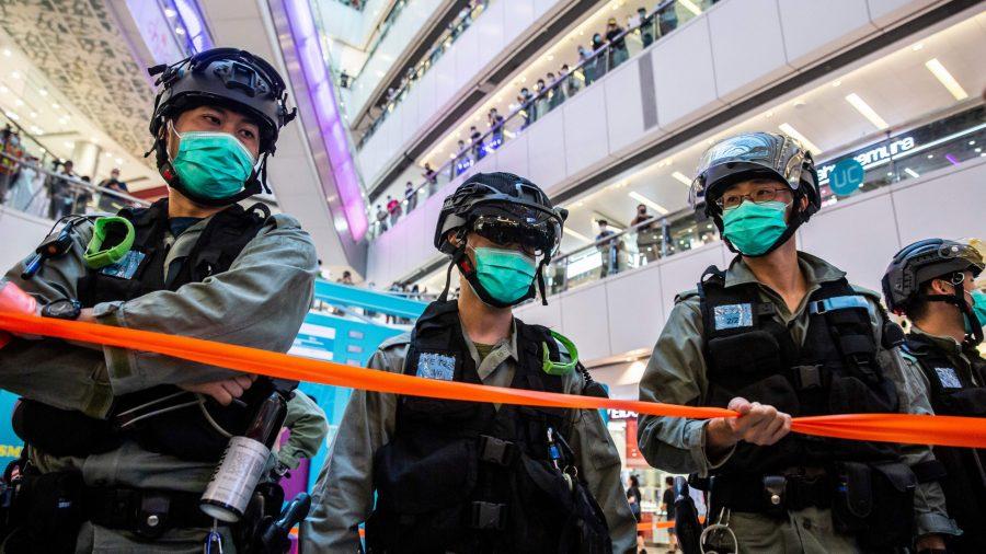 Hong Kong Arrests 10, Imposes New Media Policy